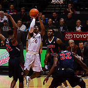 17 January 2018: San Diego State Aztecs guard Devin Watson (0) attempts a jump shot while being defended by Fresno State Bulldogs guard Deshon Taylor (21) in the first half. San Diego State leads Fresno State 40-36 at halftime at Viejas Arena. <br /> More game action at www.sdsuaztecphotos.com