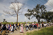Citizens of the 9th Ward of New Orleans marched over the two bridges over the industrial canal to commemorate the Hurricane Katrina disaster one year ago today..Residents of the Lower 9th threw flowers into the canal and then marched into Downtown New Orleans..