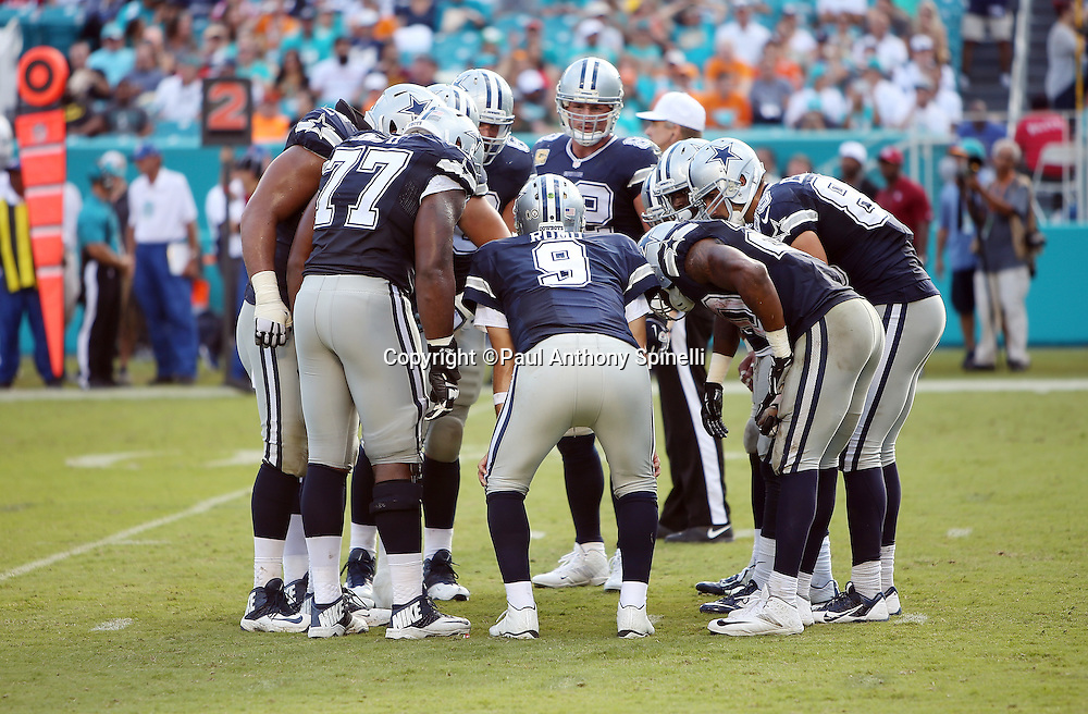 Dallas Cowboys quarterback Tony Romo (9) calls a play in the offensive huddle during the 2015 week 11 regular season NFL football game against the Miami Dolphins on Sunday, Nov. 22, 2015 in Miami Gardens, Fla. The Cowboys won the game 24-14. (©Paul Anthony Spinelli)