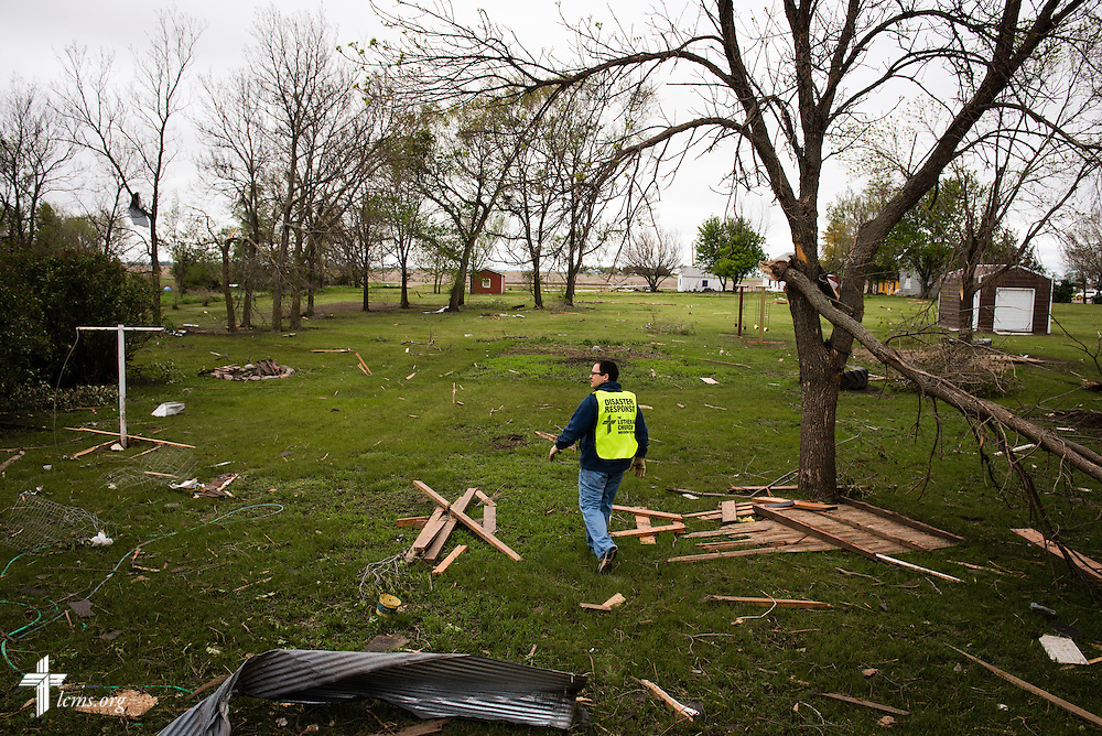 The Rev. Thomas Brown, senior pastor at Zion Lutheran Church in Mitchell, S.D. surveys the back of the parsonage on Monday, May 11, 2015, in Delmont, S.D. A tornado swept through the area the previous day and destroyed the church and nearby buildings. LCMS Communications/Erik M. Lunsford