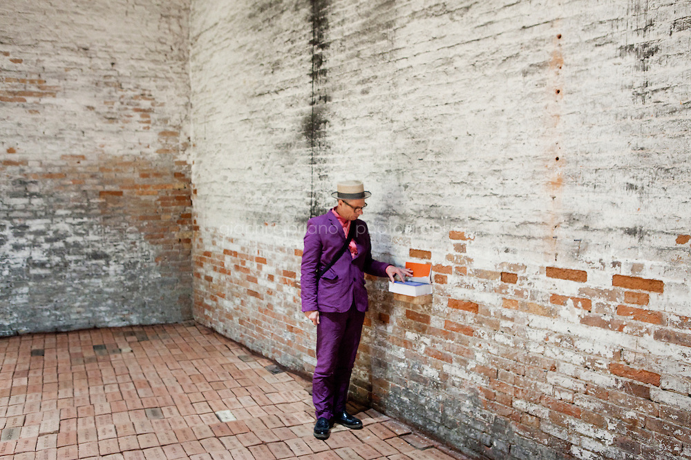 VENICE, ITALY - 31 MAY 2013: A visitor at Elisabetta Benassi's &quot;The Dry Salvages&quot; (2013) - approximately 10,000 bricks, sand, book - at the Italian Pavillon, at the Arsenale of the Biennale in Venice, Italy, on May 31st 2013. <br /> <br /> The Italian Pavilion presents vice versa, an ideal journey through Italian art of today,<br /> an itinerary that tells of identities, history and landscapes - real and imaginary - exploring the complexity and layers that characterize the country's artistic vicissitudes. The Italian Pavillon is curated by Bartolomeo Pietromarchi,<br /> who describes the exhibition as, ?A portrait of recent art, read as an atlas of themes and attitudes in dialogue with the historical legacy and current affairs, with both a local and international dimension. A cross-dialogue of correspondences, derivations and differences between acclaimed maestros and artists of later generations&quot;. The exhibition is divided into seven spaces - six rooms and a garden - that each house<br /> the work of two artists,<br /> who are brought together on the basis of the affinity of their<br /> respective poetics and common interests in themes, ideas and practices.<br /> <br /> The 55th International Art Exhibition of the Venice Biennale takes place in Venice from June 1st to November 24th, 2013 at the Giardini and at the Arsenale as well as in various venues the city. <br /> <br /> Gianni Cipriano for The New York TImes