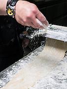 Making Tortellini pasta flattening the dough