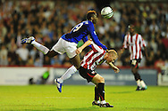 London - Tuesday, 21st September, 2010: Nicky Adams of Brentford and Magaye Gueye of Everton during the Carling Cup 3rd Round match at Griffin Park, London...Pic by: Alex Broadway/Focus Images