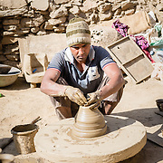 Potter making clay cups in old town Udaipur
