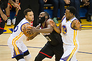 Golden State Warriors guard Stephen Curry (30) and forward Andre Iguodala (9) double team Houston Rockets guard James Harden (13) at Oracle Arena in Oakland, Calif., on December 1, 2016. (Stan Olszewski/Special to S.F. Examiner)