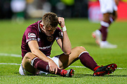 Jimmy Dunne (#3) of Heart of Midlothian reacts with frustration after Heart of Midlothian fail to win the Edinburgh Derby despite having a man advantage following the Ladbrokes Scottish Premiership match between Heart of Midlothian and Hibernian at Tynecastle Stadium, Gorgie, Scotland on 31 October 2018.