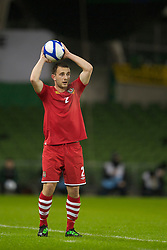 DUBLIN, IRELAND - Tuesday, February 8, 2011: Wales' Neal Eardley tales a throw-in during the opening Carling Nations Cup match against the Republic of Ireland at the Aviva Stadium (Lansdowne Road). (Photo by David Rawcliffe/Propaganda)