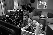 Jaime Sego, left, and Albert Rothstein listen Saturday in Florence as Jenny Marie Keris records a song. Sego and Rothstein are two emerging sound engineers in the Shoals.