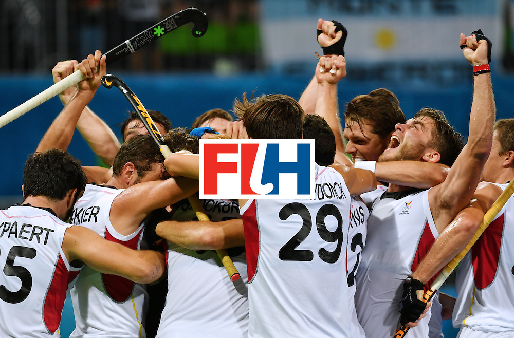 Belgium's players celebrate after winning the men's semifinal field hockey Belgium vs Netherlands match of the Rio 2016 Olympics Games at the Olympic Hockey Centre in Rio de Janeiro on August 16, 2016.  / AFP / Pascal GUYOT        (Photo credit should read PASCAL GUYOT/AFP/Getty Images)