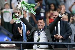 Celtic manager Brendan Rodgers lifts the Scottish Cup after victory against Motherwell in the William Hill Scottish Cup Final at Hampden Park, Glasgow.
