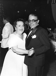 MISS ELSA MAXWELL dancing with ARISTOTLE ONASSIS at a party in Monaco in August 1957.<br /> <br /> NON EXCLUSIVE - WORLD RIGHTS