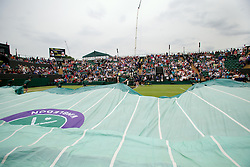 LONDON, ENGLAND - Thursday, June 27, 2013: The covers come on as rain halts the start of the Ladies' Singles 2nd Round match on day four of the Wimbledon Lawn Tennis Championships at the All England Lawn Tennis and Croquet Club. (Pic by David Rawcliffe/Propaganda)