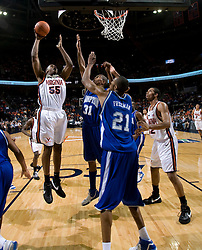 Virginia forward/center Jerome Meyinsse (55) shoots over Hampton Pirates forward Donte Harrison (31).  The Virginia Cavaliers men's basketball team defeated the Hampton Pirates 79-65 at the John Paul Jones Arena in Charlottesville, VA on December 19, 2007.