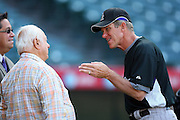 ANAHEIM, CA - JUNE 24:  Manager Jim Tracy #4 of the Colorado Rockies talks to team executive Tommy Lasorda of the Los Angeles Dodgers at batting practice before the game against the Los Angeles Angels of Anaheim at Angel Stadium on Wednesday, June 24, 2009 in Anaheim, California.  The Angels defeated the Rockies 11-3.  ©Paul Anthony Spinelli*** Local Caption *** Jim Tracy;Tommy Lasorda