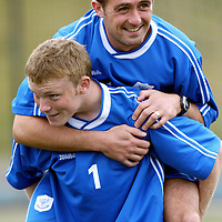 St Johnstone Training...06.08.04<br />Captain David Hannah gets a piggy back ride from Mark Baxter during training this morning.<br />see story by Gordon Bannerman Tel: 01738 553978 or 07729 865788<br />Picture by Graeme Hart.<br />Copyright Perthshire Picture Agency<br />Tel: 01738 623350  Mobile: 07990 594431