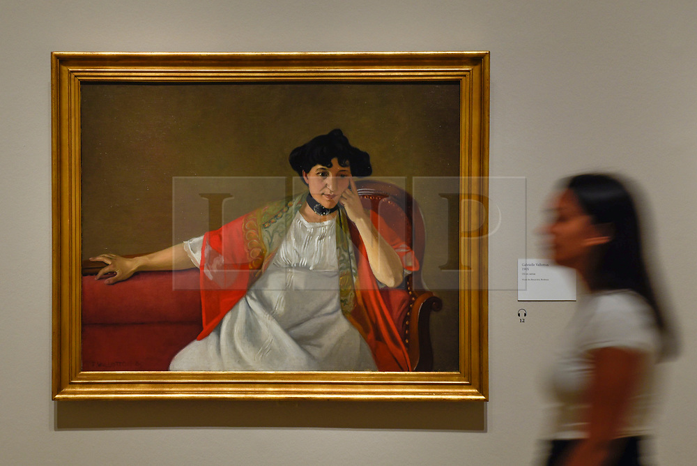 "© Licensed to London News Pictures. 27/06/2019. LONDON, UK.  A staff member walks by ""Gabrielle Vallotton"", 1905, by Félix Vallotton. Preview of ""Félix Vallotton:  Painter of Disquiet"", an exhibition of paintings and prints Swiss artist Félix Vallotton at the Royal Academy of Arts.  Around 100 works are on show 30 June to 29 September 2019.  Photo credit: Stephen Chung/LNP"