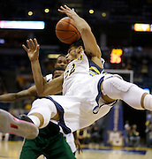 Marquette's Trent Lockett(22) looses control of the ball as he flips over a South Florida defender during the first half of an NCAA college basketball game Monday, Jan. 28, 2013, in Milwaukee. (AP Photo/Jeffrey Phelps)