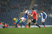 Blackburn Rovers midfielder, Elliott Bennett (31) and Brighton winger, Jamie Murphy (15) during the Sky Bet Championship match between Blackburn Rovers and Brighton and Hove Albion at Ewood Park, Blackburn, England on 16 January 2016.
