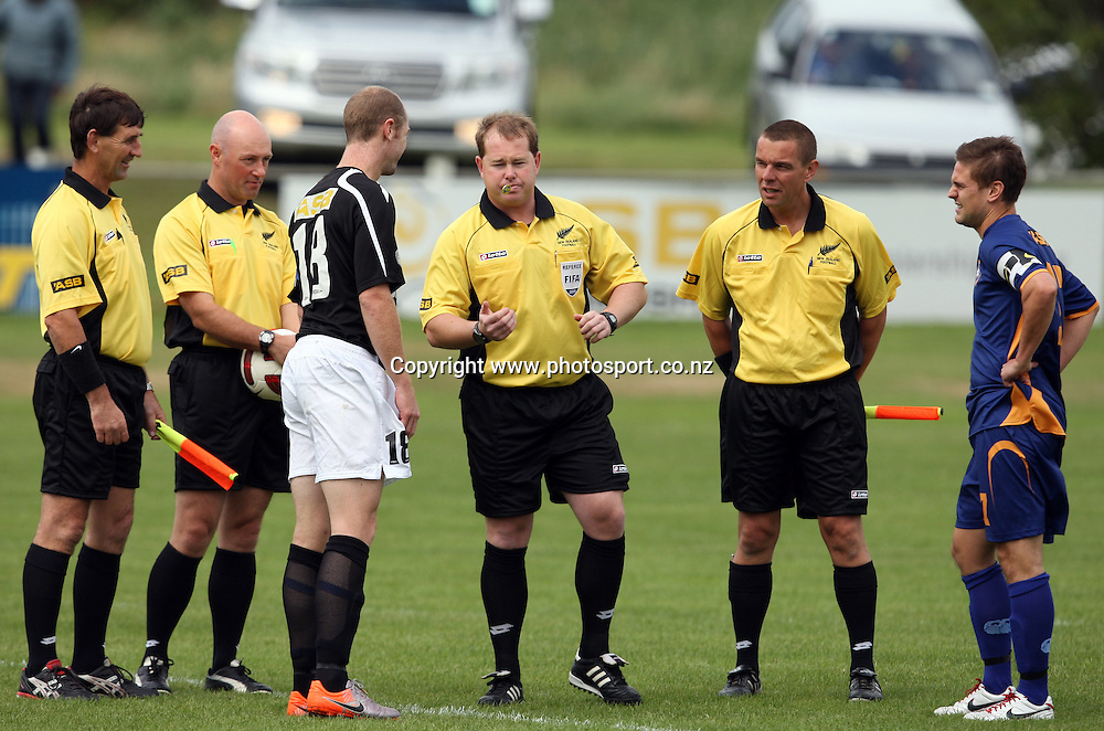 Referee Jamie Cross tosses the coin to decide directions at the start of the game.<br /> ASB Premiership Football - Otago United v Hawke's Bay United, 23 January 2011, Tahuna Park, Dunedin, New Zealand.<br /> Photo: Rob Jefferies / www.photosport.co.nz