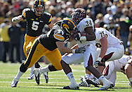 September 22 2012: Iowa Hawkeyes defensive lineman Steve Bigach (54) hits Central Michigan Chippewas running back Zurlon Tipton (34) on a run during the second half of the NCAA football game between the Central Michigan Chippewas and the Iowa Hawkeyes at Kinnick Stadium in Iowa City, Iowa on Saturday September 22, 2012. Central Michigan defeated Iowa 32-31.
