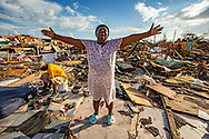 Aliana Alexis stands on the concrete slab of what is left of her home after it's destruction from Hurricane Dorian in an area called 'The Mudd' at Marsh Harbour in Great Abaco Island, Bahamas on Thursday, September 5, 2019