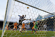 Jack Hunt of Sheffield Wednesday  clears ball from sheffields goal  during the Sky Bet Championship match between Sheffield Wednesday and Wolverhampton Wanderers at Hillsborough, Sheffield, England on 20 December 2015. Photo by Ian Lyall.