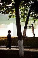 Early daily life routine for vietnamese people around Hoan Kiem Lake, Hanoi, Vietnam, Southeast Asia.