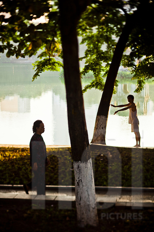Early daily life routine for vietnamese people around Hoan Kiem Lake, Hanoi, Vietnam, Southeast Asia.