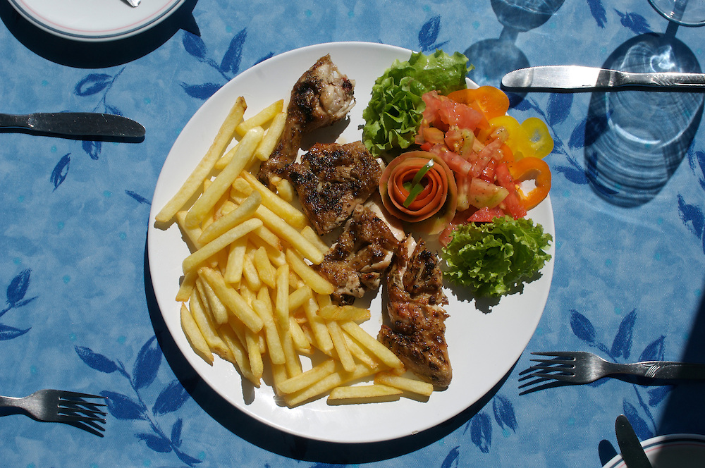 Peri-peri chicken and chips with salad