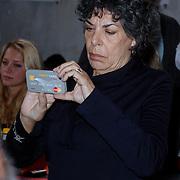 NLD/Amsterdam/20121029 - Boekpesentatie 'Het alles is Familie Kookboek', Hanneke Groenteman met haar iphone