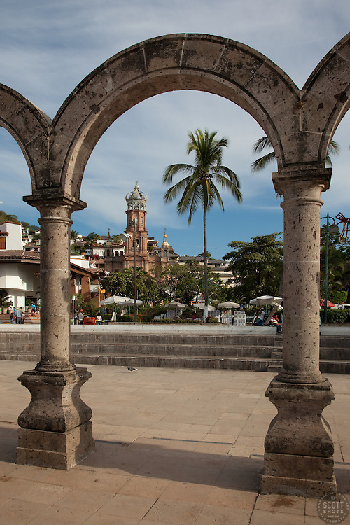 """Arcos del Malecón"" - These Arcos del Malecón and old church were photographed in Puerto Vallarta, Mexico."