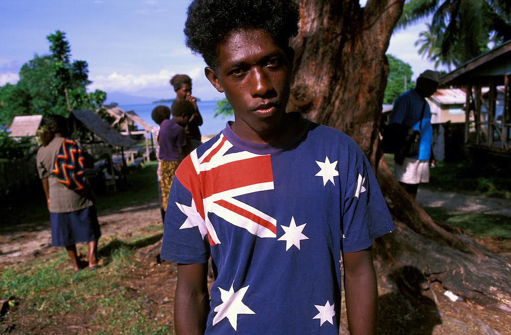 Local man wears the Australian Flag colours on his T-Shirt. Munda New Georgia Island The Solomon Islands