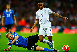 Raheem Sterling of England is tackled by Taijo Teniste of Estonia - Mandatory byline: Jason Brown/JMP - 07966 386802 - 09/10/2015- FOOTBALL - Wembley Stadium - London, England - England v Estonia - Euro 2016 Qualifying - Group E
