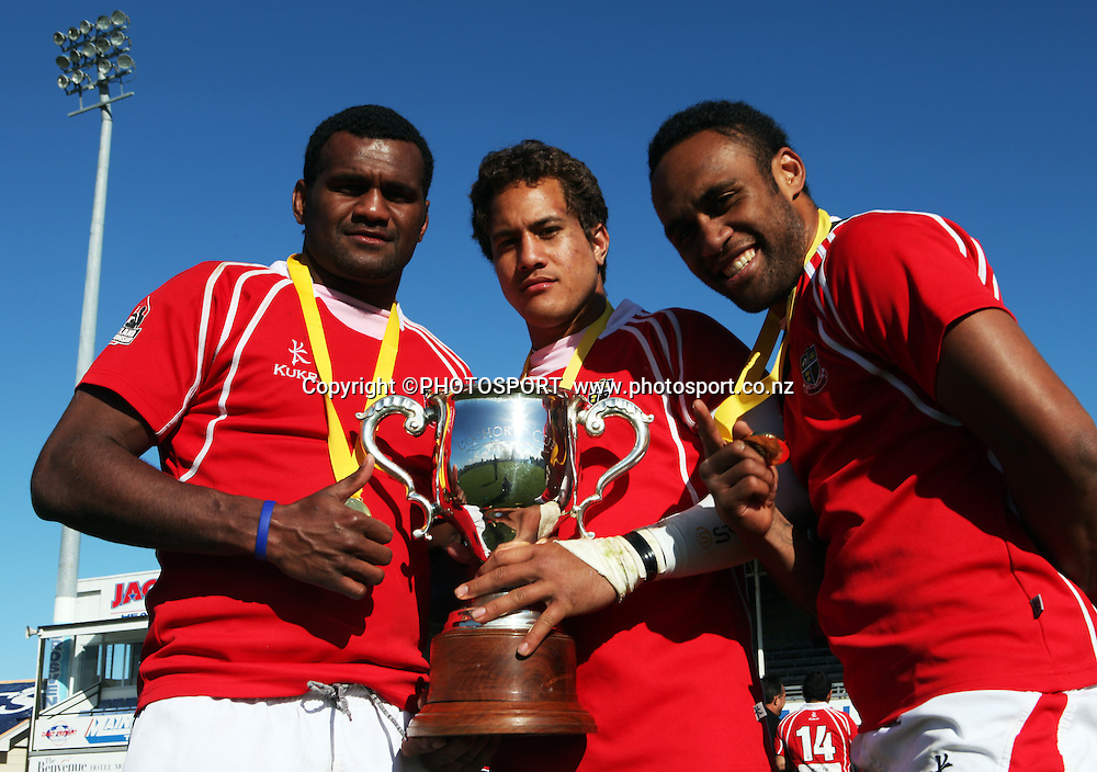 Poverty Bay team mates Paulo Tikomainaivalu, Efoti Moimoi and Ratu Vosaki with the Lochore Cup after winning the Heartland Championship Lochore Cup Final between, South Canterbury v Poverty Bay at Alpine Energy Stadium, Timaru, South Canterbury. Saturday 8 October 2011. Photo : Joseph Johnson/photosport.co.nz