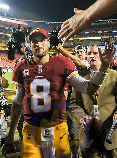 LANDOVER, MD - SEPTEMBER 24: Washington Redskins quarterback Kirk Cousins (8) walks off the field following the game against the Oakland Raiders on September 24, 2017, at FedEx Field in Landover, MD.  The Washington Redskins defeated the Oakland Raiders, 27-10. (Photo by Mark Goldman/Icon Sportswire)