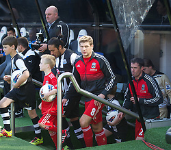 NEWCASTLE-UPON-TYNE, ENGLAND - Sunday, April 1, 2012: Liverpool's captain Steven Gerrard leads his side out to face Newcastle United during the Premiership match at St James' Park. (Pic by David Rawcliffe/Propaganda)