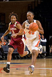 Virginia guard Enonge Stovall (40) dribbles up court on a fast break against FSU.  The Virginia Cavaliers women's basketball team defeated the Florida State Seminoles 77-58 at the John Paul Jones Arena in Charlottesville, VA on February 10, 2008.