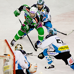 Brock McBride (HDD Tilia Olimpija, #10) vs Alex Westlund (EHC Liwest Linz, #32) during ice-hockey match between HDD Tilia Olimpija and EHC Liwest Black Wings Linz at second match in Semifinal  of EBEL league, on March 8, 2012 at Hala Tivoli, Ljubljana, Slovenia. (Photo By Matic Klansek Velej / Sportida)