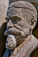 Close-up of the bust of a goateed man on a grave in Isola San Michel in Venice, Italy.