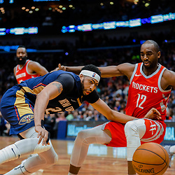 Jan 26, 2018; New Orleans, LA, USA; New Orleans Pelicans forward Anthony Davis (23) looses the ball after a collision with Houston Rockets forward Luc Mbah a Moute (12) during the second half at the Smoothie King Center. Pelicans defeated the Rockets 115-113. Mandatory Credit: Derick E. Hingle-USA TODAY Sports