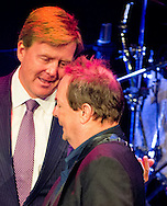 UTRECHT - King Willem-Alexander of The Netherlands meets dutch singer on one of his last performances (the singer is diagnosed with cancer) at the opening of TivoliVredenburg in Utrecht, The Netherlands, 3 July 2014. The new building have 5 concert halls for Pop, Jazz and classic music. COPYRIGHT ROBIN UTRECHT