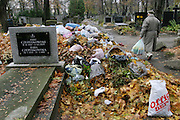 Piles of leaves and trash as the graveyard is cleaned preparing for All Saints Day. Powazek Cemetery. Warsaw, Poland.