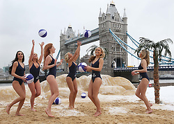 Models  at a pop up beach near Tower Bridge in London to cheer up commuters on ' Blue Monday' , reportedly the most depressing day of the year, Monday 21st  January 2013. Photo by: Stephen Lock / i-Images