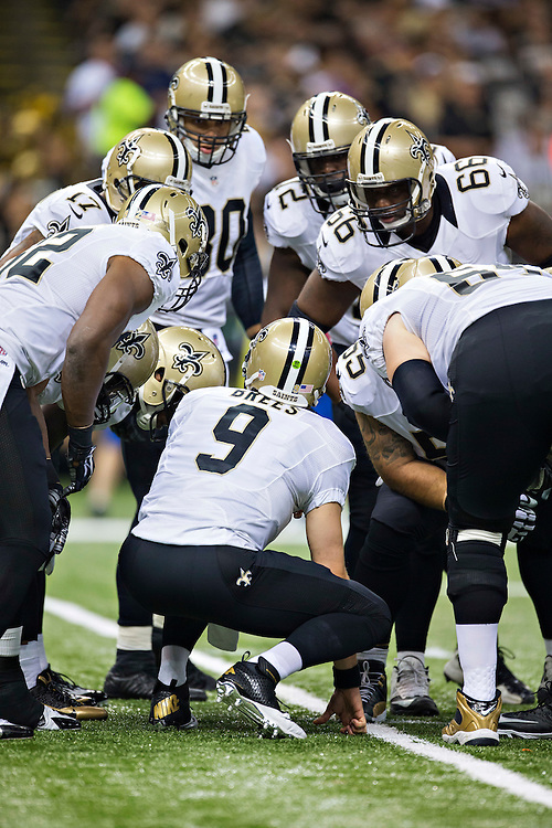 NEW ORLEANS, LA - SEPTEMBER 21:  Drew Brees #9 of the New Orleans Saints in the huddle during a game against the Minnesota Vikings at Mercedes-Benz Superdome on September 21, 2014 in New Orleans, Louisiana.  The Saints defeated the Vikings 20-9.  (Photo by Wesley Hitt/Getty Images) *** Local Caption *** Drew Brees