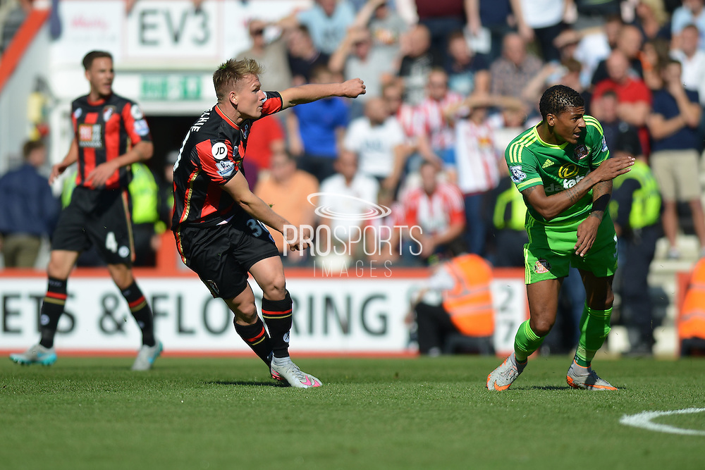 AFC Bournemouth's midfielder Matt Ritchie scores the second goal during the Barclays Premier League match between Bournemouth and Sunderland at the Goldsands Stadium, Bournemouth, England on 19 September 2015. Photo by Mark Davies.