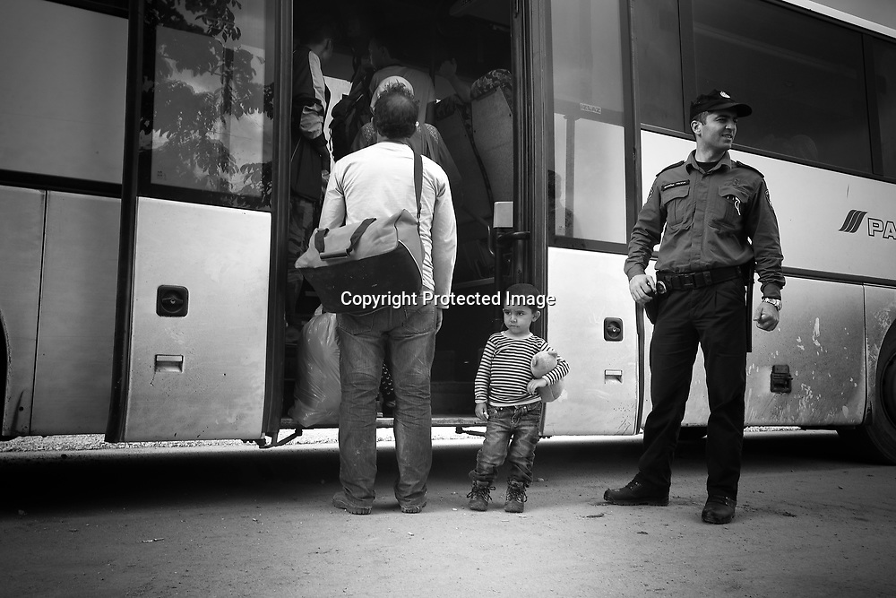 Immigrants and or refugees catching the bus in the Croatia border town of Bapska. Little boy hold on to his ted bear before getting in the bus to Opotovak Camp 30 minutes away where they will rest for a few hours before keep going to the Hungarian border.