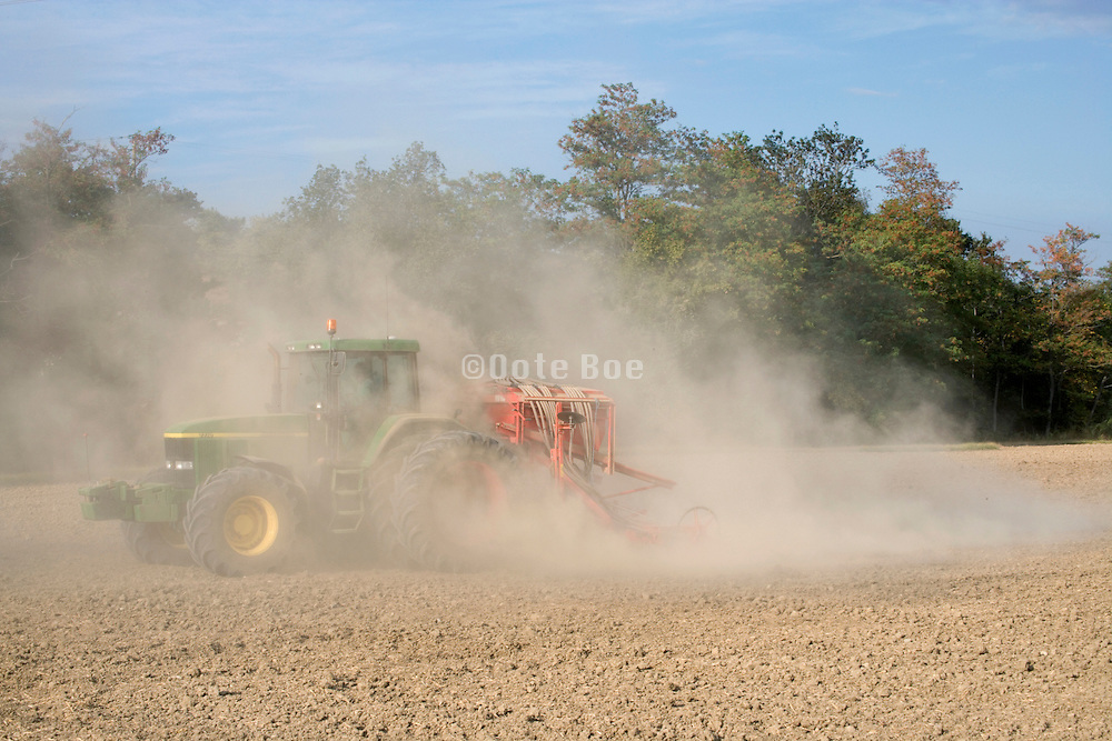 tractor working in a dust cloud