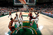 February 8, 2017: Anthony Lawrence, Jr. #3 of Miami tries to block the shot from Justin Robinson #5 of Virginia Tech during the NCAA basketball game between the Miami Hurricanes and the Virginia Tech Hokies in Coral Gables, Florida. The 'Canes defeated the Hokies 74-68.