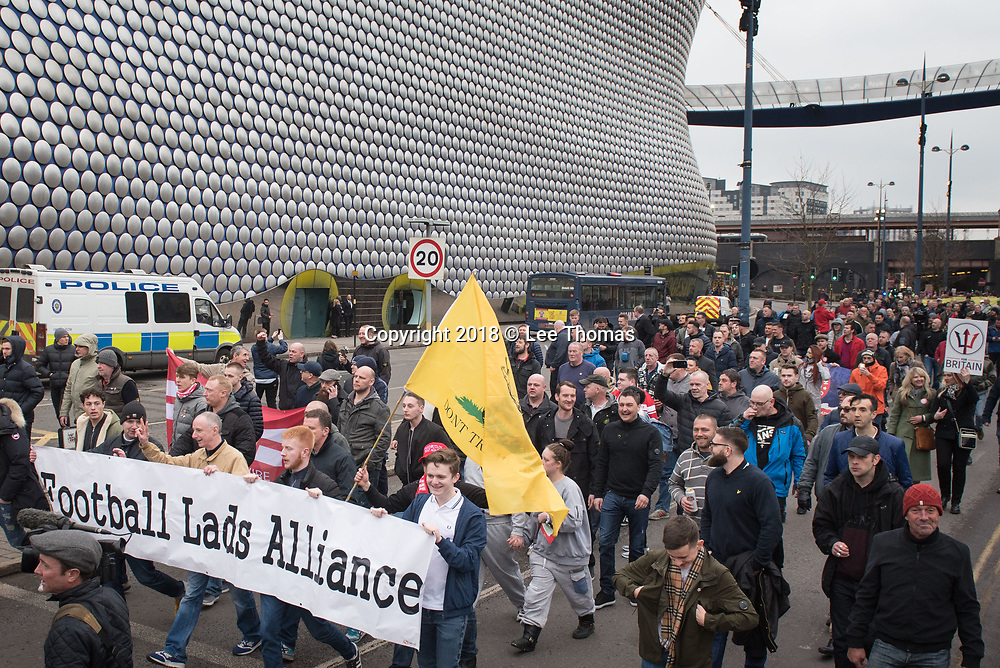 Birmingham, West Midlands, UK. 24th March 2018. Thousands of demonstrators converge on Birmingham city centre organised by three individual groups: Football Lads Alliance (FLA), Democratic Football Lads Alliance (DFLA) and Stand Up To Racism.  Pictured: THe FDL march passes the iconic Selfridges building. // Lee Thomas, Tel. 07784142973. Email: leepthomas@gmail.com  www.leept.co.uk (0000635435)