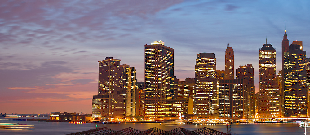 Panorama view of Lower Manhattan skyline at sunset